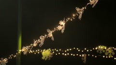 Blurred image of light bulbs outdoor on a wire, holiday concept Stock Footage