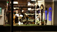 Old moving dolls in front of an old antique shop Stock Footage