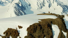 Aerial view of climbers crossing a snow covered mountain range in Alaska USA Stock Footage