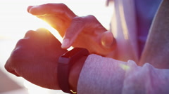 African American male doing cardio fitness sport with smart watch on his wrist Stock Footage