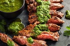 Homemade Cooked Skirt Steak with Chimichurri - stock photo