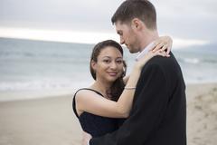 Romantic Interracial Couple at the Beach - stock photo