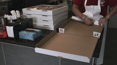 Folding a pizza box at a pizza shop Stock Footage