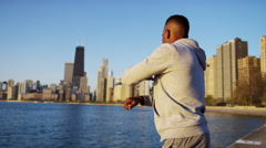 Healthy fit Ethnic African American male stretching and resting in Chicago city Stock Footage