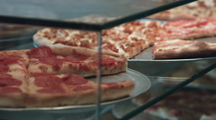 Pizza on display at a pizzeria Stock Footage