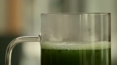 Close up of pouring and stirring matcha - stock footage
