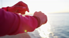 Hispanic Caucasian female wrist in sun flare with smart watch for cardio workout Stock Footage