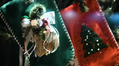 Close up of christmas stockings in front of out of focus Christmas tree - stock footage