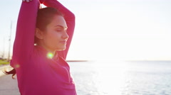 Portrait of Hispanic Caucasian female in sun flare in Chicago city stretching Stock Footage