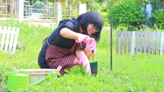 Asian woman working in home garden Stock Footage