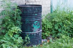 Figure on an black ordinary barrel Stock Photos