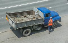 Antiquated Garbage Truck With Blue Cabin. Worker Near First One. Stock Photos