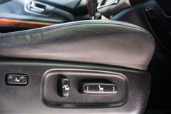 Electric seat adjustment of a car Stock Photos