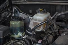 Steering fluid and brake fluid reservoirs Stock Photos