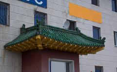 Facade of the building decorated with Chinese rooftop Stock Photos