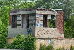 The destroyed building among the trees. Stock Photos