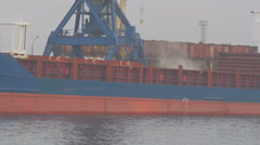 Cargo ships on the pier swims past. cargo ship, port, ships Stock Footage