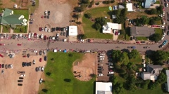 Aerial ascending shot of families watching the july 4th parade Stock Footage