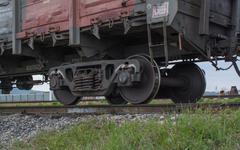 Metal wheels of a cargo train - stock photo