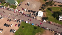 Aerial descending shot of families watching the july 4th parade Stock Footage