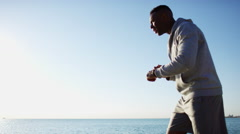 Ethnic African American male doing running training to stay fit in Chicago Stock Footage