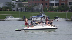 Family floating on a boat in the river in Pittsburgh Stock Footage