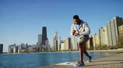 Ethnic African American male doing running and stretching with smart watch Stock Footage