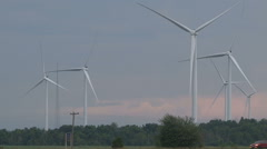 Renewable green energy wind turbines standing still on hot day - stock footage