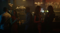 4K Young diverse group socializing & bar staff serving drinks in trendy city bar Stock Footage