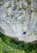 male rock climber on the cliff - stock photo