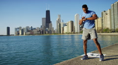 Ethnic African American male doing cardio sport running workout with smart watch Stock Footage