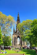 Princes Street garden with Scott Monument full of people in a sunny summer day Stock Photos