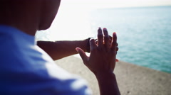 Close up of Ethnic African American male wrist in sun flare doing fitness Stock Footage
