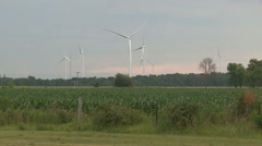 Renewable green energy wind turbines standing still on hot day Stock Footage