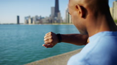 Close up of Ethnic African American male wrist in sun flare checking smart watch Stock Footage