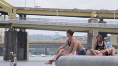 Women enjoying the summer heat at the Point State Park Fountain in Pittsburgh Stock Footage