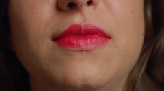 Caucasian woman in red lipstick gives camera a toothy smile. Stock Footage