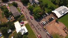 Aerial panning shot of families watching a july 4th parade Stock Footage