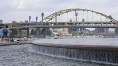 People cooling off by a fountain in Pittsburgh Stock Footage