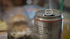 Beer can on a table during a party Stock Footage