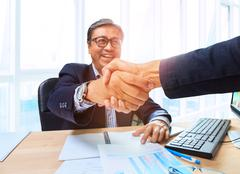 two business man shaking hand with happiness emotion after agreement in worki - stock photo