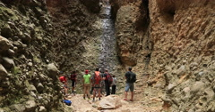 Climbing waterfall end of box canyon Scout troop DCI 4K Stock Footage