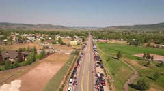 Aerial shot of families waiting for parade to start Stock Footage