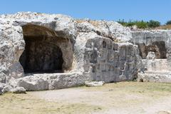 Rock dwellings at Archaeological Park Neapolis at Syracusa, Sicily - stock photo