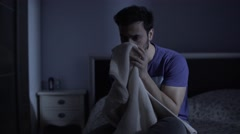 Depressed man smelling his ex-girlfirend sweater in bedroom Stock Footage