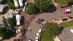 Aerial shot of families watching a july 4th parade Stock Footage