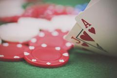 Poker chips and cards on a green table Kuvituskuvat