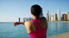 Ethnic African American female in city stretching to stay fit after workout Stock Footage