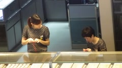 Female employees of the gold jewelry store - stock footage