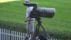 A cameraman from the Czech national TV channel with a huge camera - stock footage